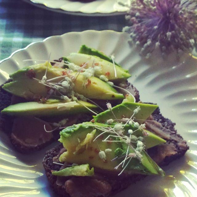 Sourdough with miso, refried beans, avocado, onion Namaste Nutritionist