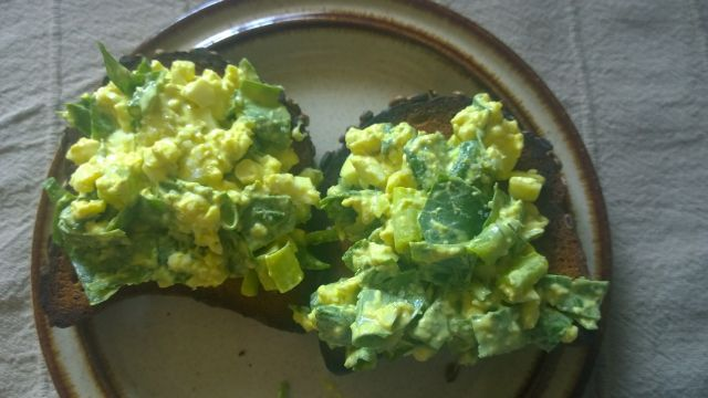 Egg salad with spinach green onion on sourdough